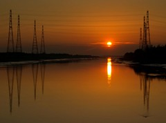 Scenic Sunset at Preston (Tony Worrall Foto) Tags: county uk sunset england sky sun wet water beauty marina docks river gold golden nice stream tour open place northwest unitedkingdom dusk country north scenic sunny visit scene images location calm lancashire area preston colourful northern pylons goldensunset update masts hue attraction settingsun lancs riverribble riversway prestondocks prestonmarina ashtononribble welovethenorth