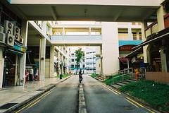 Crossing (OzGFK) Tags: asia singapore jurongeast street streetphotography people hdb film analog nikon nikkor lomography800 local