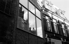 amsterdam window reflection (McArthur) Tags: bw film 135 minox35 fujineopanacros