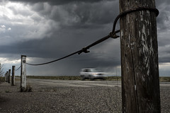 storm chaser (marianna_a.) Tags: park usa storm motion blur car rain weather metal clouds fence dark sand colorado moody post dunes chain mariannaarmata p2520785