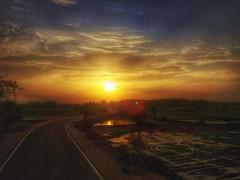 Sun way (saptarshiriju) Tags: sunray highway nature cloud golden landscape india village reflection
