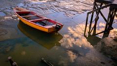 Caleta Tortel Sunset (mauro_332) Tags: chile wood sea en sol rio river de mar madera reflejo puesta bote caleta tortel fiordos