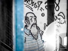 "Street Art near the ""Boutique Taberna"", Lisbon Portugal (Sebastian Bayer) Tags: street trip blue vacation white streetart man reflection art portugal window wall contrast graffiti spring comic outdoor drawing lisboa lisbon fenster wand kunst urlaub olympus graffity mann lissabon blau paintbrush airbrush omd reflektion frhling zeichnung malerei wandmalerei weis strase drausen strasenkunst 124028 omdem5ii boutiquetaberna"