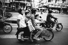 The Vietnamese Style of Transportation... (desomnis) Tags: street travel family bw monochrome kids drive blackwhite driving transport streetphotography streetlife vietnam motorbike traveling hochiminhcity hcmc travelphotography streetcandid sigma35mm canon6d desomnis