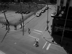 Halifax, NS (Avard Woolaver) Tags: light blackandwhite bw canada bicycle photo novascotia shadows noiretblanc aerialview pedestrians intersection windowview halifax crosswalk hrm sackvillestreet hollisstreet sociallandscape canonpowershota4000