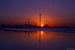 Pleasure Pier Sunrise (DirkSnaps) Tags: ocean morning blue orange galveston water yellow sunrise mexico dawn pier am waves texas gulf purple salt calm roller ambient rides coaster pleasure