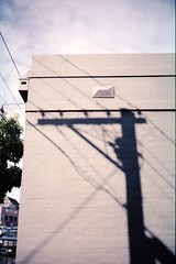 wired (lonely radio) Tags: trees sky film clouds 35mm t shadows australia melbourne victoria wires walls f28 contaxt3 cremorne pc3121 sonnar carlzeiss auspctagged kodakportra160nc scansf20130525t3p16014