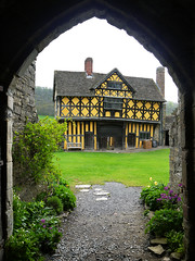The Gatehouse From The Castle (Louise and Colin) Tags: old uk england black castle english heritage history beautiful yellow shropshire britain path framed decorative eu medieval tudor explore british lovely quirky halftimbered manorhouse 16thcentury fortified englishheritage stokesaycastle flickrexplore explored gablewindow tudorchimneys louiseenglish