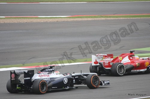 Pastor Maldonado and Fernando Alonso in Free Practice 2 at the 2013 British Grand Prix