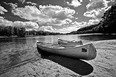 Tranquility (Riddhish Chakraborty) Tags: bw texture nature sunshine horizontal river photography boat sand day cloudy perspective wideangle