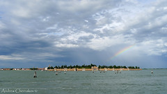 Rainbow over San Michele (Andrew Chernakov) Tags: travel venice light sea sky cloud reflection history tourism water clouds island rainbow san europe italia view air religion places historical michele laguna acqua venezia isola veneto