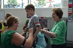 "Teacher Amy Lund and volunteer Debbi S. help Bell Particiapnt Christopher into his climbing harness. • <a style=""font-size:0.8em;"" href=""http://www.flickr.com/photos/29389111@N07/9544552990/"" target=""_blank"">View on Flickr</a>"