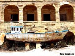 Comino, boat, hospital (David Ripamonti) Tags: old summer canon hospital landscape eos boat sand mare ship view malta shore gozo comino