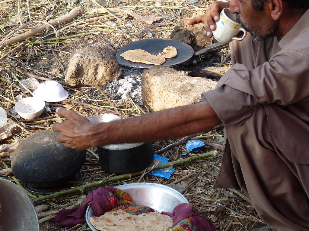 Image result for cooking with coal, pakistan, photos