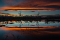 En Fuego (Bill Bowman) Tags: sunset reflection night cloudy bouldercolorado sawhillponds