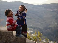 Laughters (Christian Lagat) Tags: china girls sunset two evening child laugh deux 中国 yunnan soir enfant filles chine rire bada minorities 云南 二 minorités sonynex6