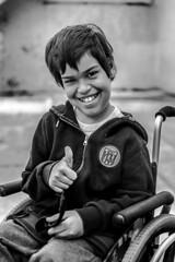 Joaquin (santiagoamado) Tags: street portrait urban blackandwhite blancoynegro smile face kid nikon yes gesture risa gesto
