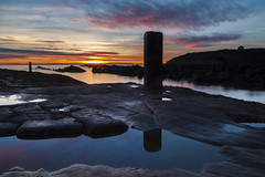 Monolithic reflections (Christian Hacker) Tags: ocean pink sunset shadow sea sky orange sun seascape seaweed cold nature water pool vertical clouds canon reflections dark landscape puddle eos coast scotland rocks long exposure december day cloudy harbour fife dusk horizon silhouettes rocky scottish pole forth coastal kelp colourful monolith rugged firth pittenweem monolithic 50d
