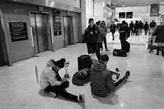"Insensitive People (Kenji ""hamachan"" Nagahama) Tags: street bw paris france monochrome airport candid terminal disturbing generation charlesdegaulle mobiledevice sittingonthefloor"