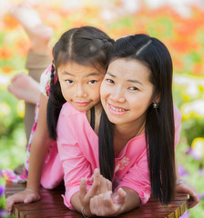 Asian little girl and  mother (anekphoto) Tags: park family light summer portrait sun game flower cute green nature girl beautiful grass childhood smiling yellow female season mom asian fun outdoors happy person kid spring soap healthy funny pretty child play little innocent daughter young mother meadow happiness bubbles blowing blow human thai sunflower positive lovely sunbeam caucasian