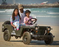 Small driver - small jeep (Alexander Sidorov aka Alex Sidoroff) Tags: family red dubai jeep military burjalarab sunsetbeach