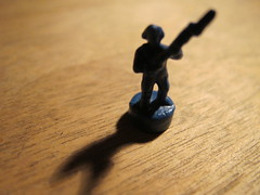 1cm tall soldier and his shadow (marly.jane) Tags: wood blue shadow man macro canon toy soldier army small grain mini plastic tiny weapon figurine g11 gamepiece marlyjane