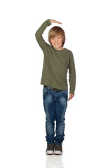 Happy preteen boy pointing measuring what has grown (leanhtuce) Tags: boy portrait people cute male beautiful beauty smile childhood smiling laughing hair fun happy person one kid student spain education child hand little head expression background young grow handsome happiness son teen blond teenager casual cheerful bang measure height isolated offspring preteen caucasian measured