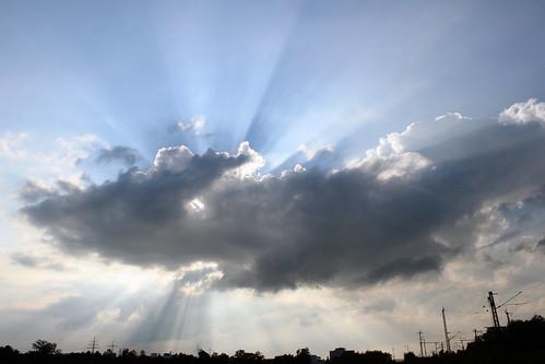 Sun behind the cloud
