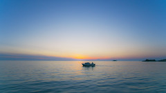 Sailing Alone (Tom Mrazek) Tags: sunset sea summer sky sun nature colors night landscape evening boat seaside ship nightscape vivid croatia