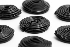 Craving a candy? (tounesse) Tags: bw macro candy noiretblanc sweet creative liquorice licorice bonbon haribo 105mm rglisse d90 rotella sb900