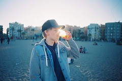 lil bro's surprise visit (amanda aura) Tags: barcelona film beach beer spain brother lomolca drinks