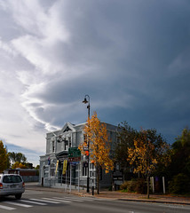 Big Drops Starting to Fall (Jocey K) Tags: street autumn trees newzealand sky signs cars lamp clouds buildings town shadows southisland geraldine zebracrossing archtiecture southcanterbury tripdownsouth