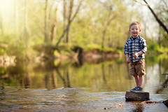 Skipping Stone (searley86) Tags: child boy water river stones trees stream toddler children kids sunlight sun light natural prime primelens nikon 85mm