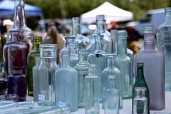 Bottles at Wellfleet Flea (Read2me) Tags: cye capecod glass bottles dof market sale table many thechallengefactorywinner tcfunanimous pregamewinner superherowinner challengeclubwinner gamesweep gamesweepwinner