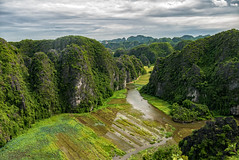 View over Tam Coc, Ninh Binh, Vietnam (edin86) Tags: travel mountains green water river landscape rice hills vietnam lush agriculture hanoi karsts lumixg7
