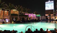 Dive In Featured (UNLV Rebel Yell) Tags: pool palm trees night lights cosmopolitan city view