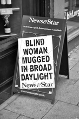 Billboard news. (Raymondo166) Tags: woman eye shop walking blind story past caught shocking mugged newsagents