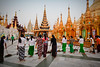 Sweeping Shwedagon Paya (Lil [Kristen Elsby]) Tags: travel topv2222 architecture asia southeastasia dusk shwedagon yangon burma cleaning frombehind editorial myanmar sweep shwedagonpagoda rangoon sweeping longyi travelphotography shwedagonpaya shwedagonzedidaw buddhistarchitecture canon5dmarkii htamain myanmar2012