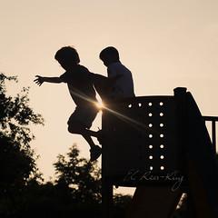 Leap of faith... (- e l i -) Tags: boys playground evening jump elirees