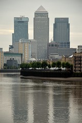 Canary Wharf 1 (Part of a Series) (A-Lister Photography) Tags: city uk morning light portrait urban reflection building london wet water horizontal skyline architecture modern clouds docks buildings reflections river dawn early still apartments cityscape shadows riverside cloudy relaxing earlymorning peaceful icon fresh business flats docklands recreation innercity relaxation riverbank goodmorning canarywharf iconic financial riverthames economy modernarchitecture greysky daybreak cityoflondon finance watery londonicon wetreflections riverwall iconiclondon adamlister nikond5100 alisterphotography