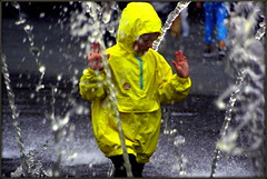 Wall of water (* RICHARD M) Tags: street wet water yellow liverpool fun hoodie action candid plastic hoody hood fountains candids anorak daredevil soaked drenched daring merseyside williamsonsquare hiviz cagoule raisedhands wetwetwet thedecisivemoment waterproofs kagool wallofwater cagoul rainhood kagoule fountainfun waterproofjacket weatherwear waterproofcoat