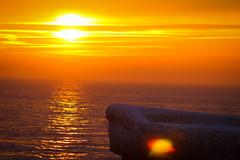 Sun and sea (Hkan Dahlstrm) Tags: winter sunset sky orange ice port se harbor skne sweden sverige uncropped trelleborg 2014 f32 smygehuk skneln ef200mmf28lusm canoneos100d sek 7002022014162740