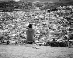 What  ? (halifaxlight (back in March)) Tags: bw panorama man morocco thinking medina outlook seated soe oldcity lookoff fes contemplation greatphotographers