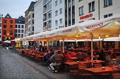 Cologne (Mark Wordy) Tags: germany square deutschland restaurant town bars market cologne seating umbrellas koln heumarkt maredo
