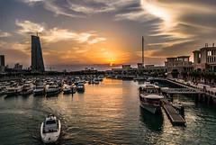Marina, Souq Sharq (Azarbhaijaan) Tags: red sky sun yellow boats bluesky kuwait kuwaitcity cbk pakistaniphotographer pentaxk10d azharmunir drpanga