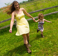 Rebecca & Chloe15 (to.photography) Tags: park family blue red summer brown sun white flower green love nature girl grass sunshine yellow laughing fence walking mom outside outdoors photography warm child dress purple photoshoot boots pair spin mommy daughter mother smiles warmth chloe mama dresses shade spinning rrr cowgirl rd cvr owens barndoor cowgirlboots motherdaughtershoot tophotography jumpingg taylorwowens rebeccarackley chloerackley