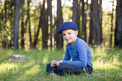 Child Portraits (Kirsten Goebel of Pine Tree Productions) Tags: blue trees green smile backlight model country relaxing jeans cap pineforest greengrass countryair impressioniststyle childportraitphotographer kirstengoebel pinetreeproductions