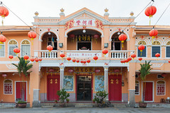 Teoh Kongsi clan house (Evgeny Ermakov) Tags: door city travel houses red building tourism bike bicycle yellow architecture asian religious temple town george ancient asia southeastasia arch religion chinese culture georgetown holy malaysia lanterns destination lantern penang southeast clan kongsi touristic clanhouse teoh editorialuse teohkongsi
