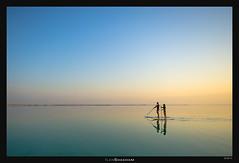 Endless Paddling (Ilan Shacham) Tags: sea two woman man reflection water sport sunrise dawn israel couple tranquility calm wanderlust adventure serenity paddling deadsea sup endless paddleboard standuppaddleboard