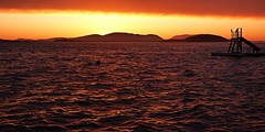 San Juan Islands Sunset (Aneonrib) Tags: sunset sky cloud water silhouette clouds island islands golden evening bay washington san purple juan outdoor dusk r bayview skagit coastline waterslide orcas buoy padilla guemas
